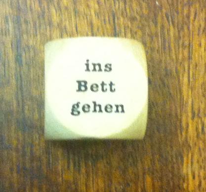 """The die says """"Ins Bett Gehen"""""""