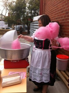 Me, in a dirndl, holding fairy floss sticks like Bier Steins
